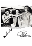 ALI V. FORMAN ZAIRE FIGHT PAGE SIGNED BY MUHAMMAD ALI & GEORGE FORMAN